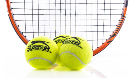 SWINDON, UK - APRIL 15, 2018: Head Tennis Racket and Slazenger Ball on a white background