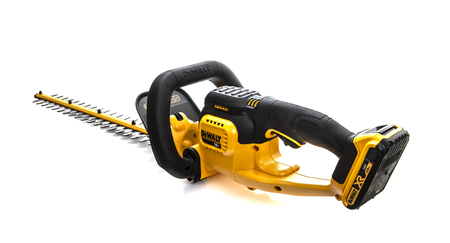 SWINDON, UK - JULY 31, 2018: DeWalt cordless Hedge Trimmer on a white background
