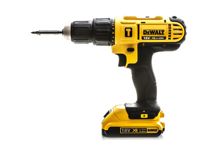 SWINDON, UK - JULY 31, 2018: DeWalt cordless Power Drill on a white background Publikacyjne