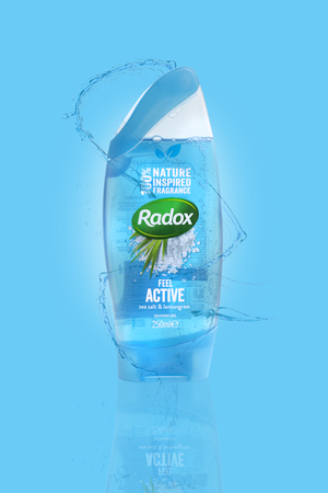 SWINDON, UK - MARCH 3, 2019: Radox Sea Salt and Lemon Grass Shower Gel on a light blue and water splashed background
