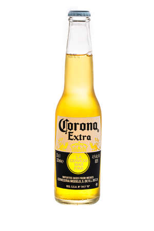 SWINDON, UK - MARCH 12, 2021: Bottle of Corona extra mexican beer on a white background