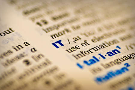Closeup of the word IT in a dictionary