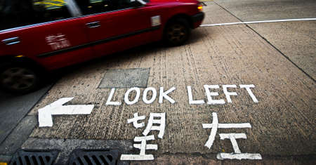 reminding: A sign at a street crossing in Hong Kong reminding tourists to look left before crossing