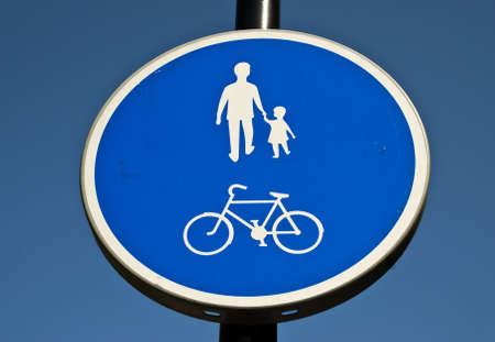 A close up of a blue and white walking and cycling sign Stock Photo