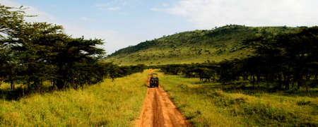 A car traveling on a dirt road in africa