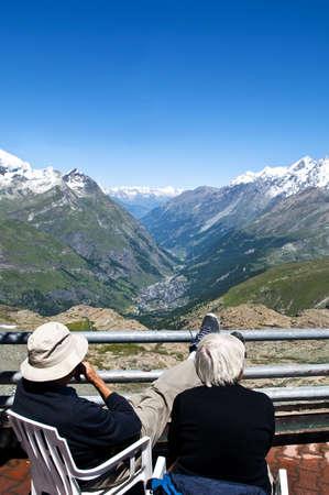 An elderly couple enjoying the view overlooking Zermatt, Switzerland, Picture taken 2008-07-15
