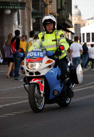 A Swedish police motorcycle in Stockholm during Stockholm Marathon 1020. Picture taken in Stockholm, Sweden, June 5 2010 Editorial