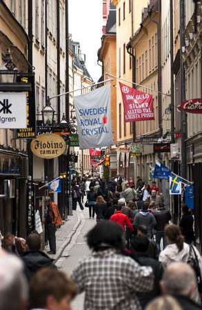 Tourists strolling on a street in Stockholms Old town area, Picture taken in Stockholm, Sweden May 16, 2010