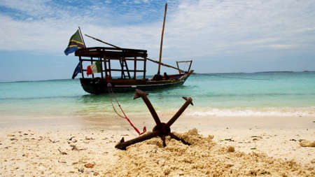 A fishing boat anchored by the beach in Zanzibar photo