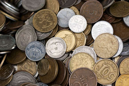 A collection of coins from different countries Stock Photo
