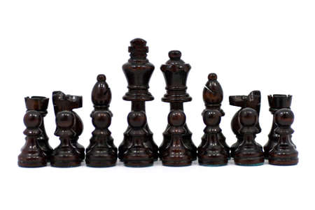 A set of black chess pieces with white background