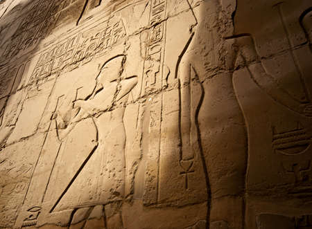 hieroglyphs on a wall in the karnak temple in luxor