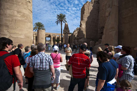 luxor: Karnak temple, Luxor, Egypt. Jan. 13th 2011. A guide with a group of tourists. Tourism in Egypt makes up about 11 percent of the gross domestic product and has been hit hard by the recent unrest in the country.