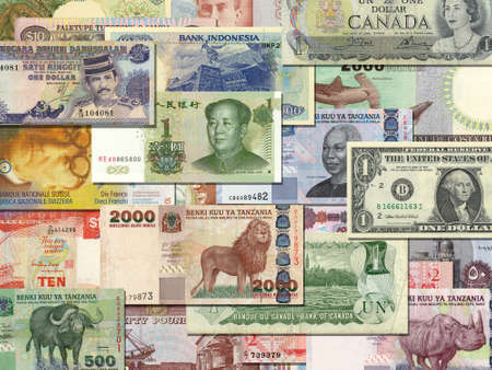 banknotes from different countries overlapping each other Stock Photo
