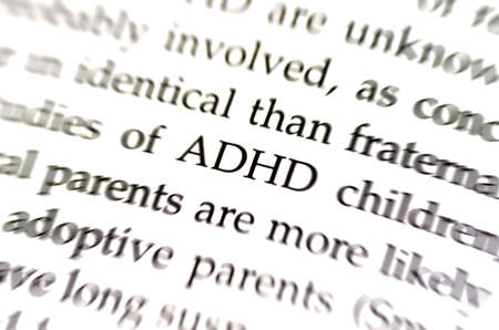 hyperactivity: the word adhd in focus surrounded by blurred words