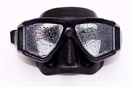 A black dive mask with water on it Stock Photo