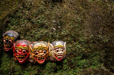 traditional balinese masks hanging on a wall