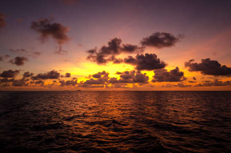 A beautiful orange sunset over the waters of the Maldives