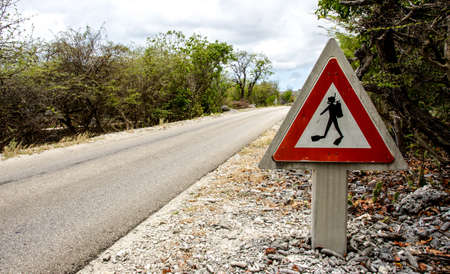 a traffic sign warning drivers about divers crossing the road Stock Photo