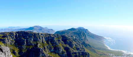 View over mountains and the ocean from the top of Table Mountain outside Cape Town in South Africa Stock Photo