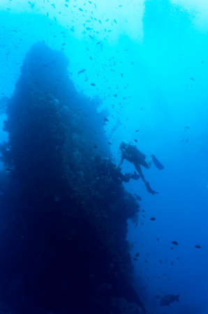 ship wreck: Divers swimming at a wreck in Bali Indonesia