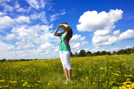 attention; curious; demonstrate; direction; female; field; green; hand; happiness; incredible; interesting; look; looking; meadow; nature; pointing; sensation; sky; surprised; to discover; to present; view; woman; watching; Stock Photo - 14560462