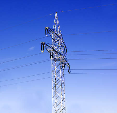 electricity pylon and a beautiful blue sky Stock Photo
