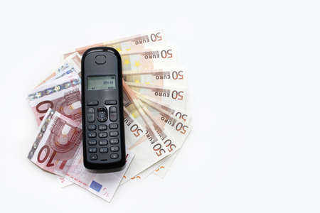 Wireless telephone on banknotes photo