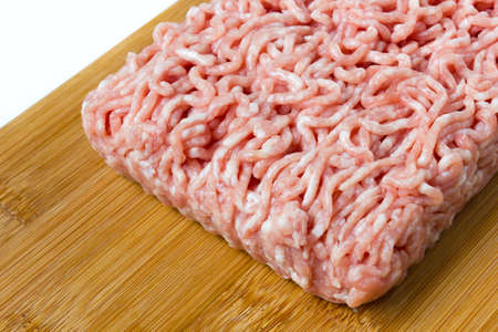 minced meat on a wooden cutting board Stock Photo