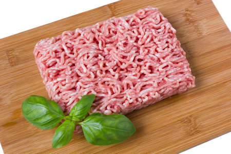 minced basil on a cutting board with