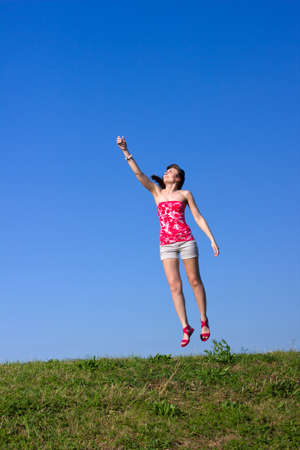 beautiful young woman is flying up Stock Photo - 14689605