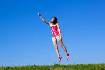 beautiful young woman is flying up  photo