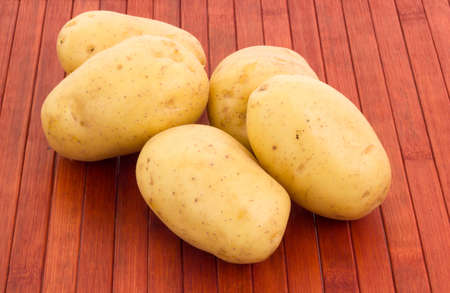 potatoes on wooded background