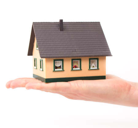 Realty concept - hand holding house Stock Photo