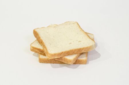 Three white bread on top of each other