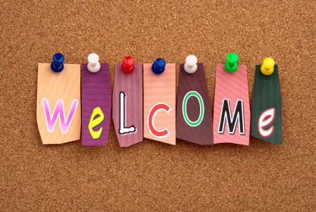 Welcome pinned on cork bulletin board photo