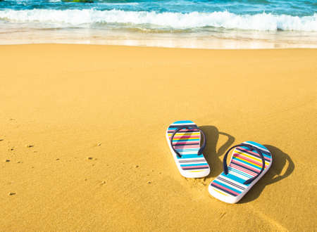 Colorful sandals on beach , copy space photo