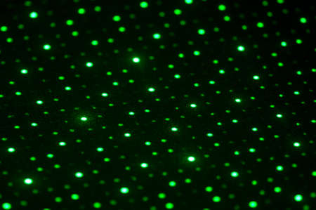 Green laser lights on black background Фото со стока