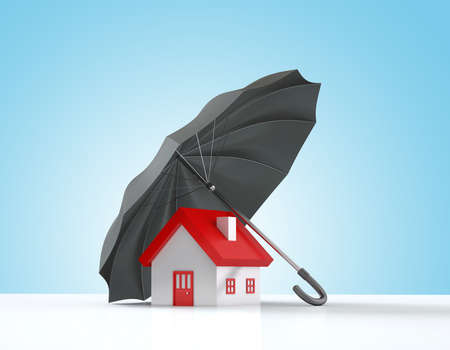 Insurance Concept , Home is protected by a black umbrella
