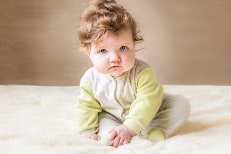 Beautiful little baby sitting.