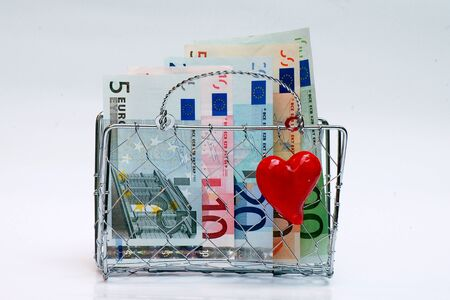 It's a lady's little purse woven wire mesh with euros. Stock Photo - 13842737