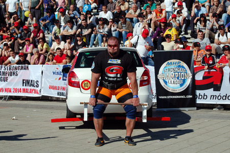 strongman: The strongman lifts the car on Strongman Championship in Novi Sad in Serbia  Editorial