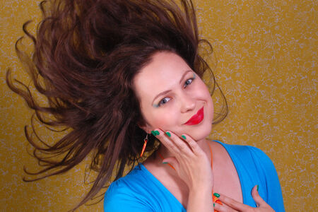 flying hair: Portrait about woman with colorful make up and flying hair