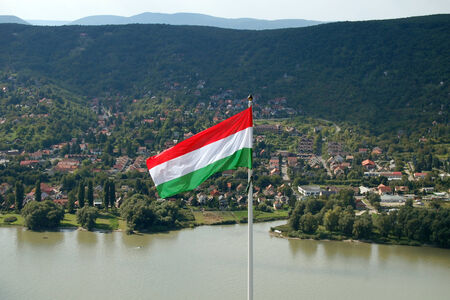 visegrad: The hungarian flag with beautiful landscape background.