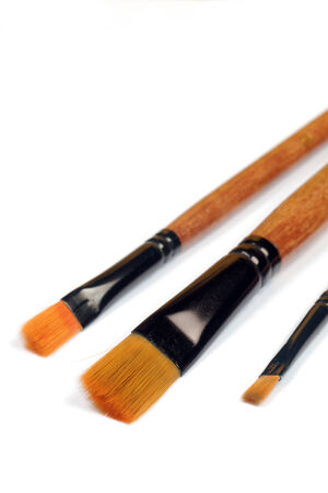 Three paintbrushes are on the white background. photo