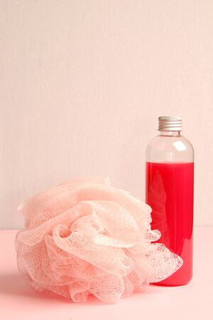 bath sponge: Still life from red shower gel and bath sponge. Stock Photo