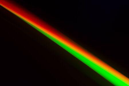 diagonal: Colorful diagonal stripe is on black background. Stock Photo