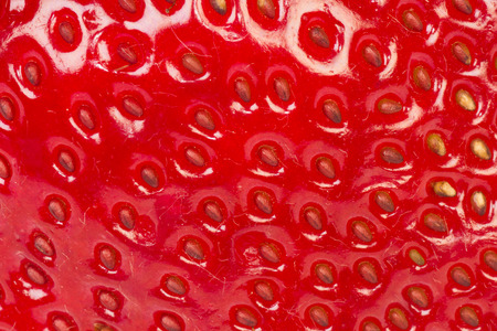 extreme close up: Extreme close up about strawberry surface as texture background.