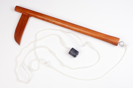 traditional weapon: Wooden kusarigama, traditional japanese weapon is on isolated white background.
