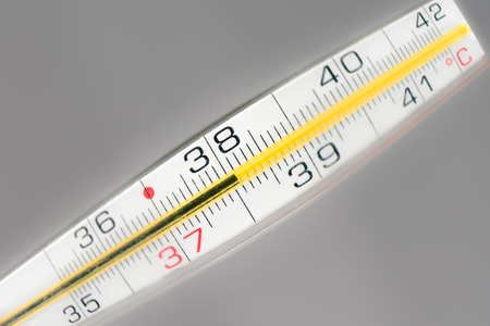 celsius: Thermometer shows 38 celsius, sick temperature, fever. Stock Photo